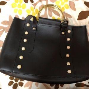 Black pearl studded bag